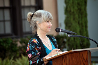 """Jill Hall reads """"Tiny Dancer"""" at the book party"""